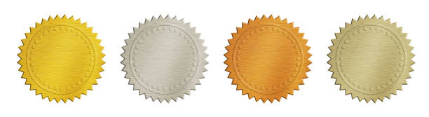 Gold and silver brushed metal badges over white stock photo