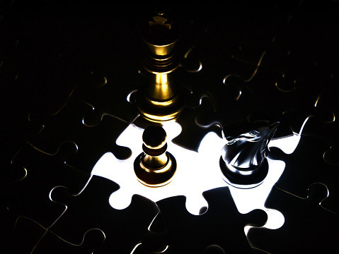 Gold And Silver Chess Piece On Jigsaw Puzzle Background Business Concept Stock Photo - Download Image Now