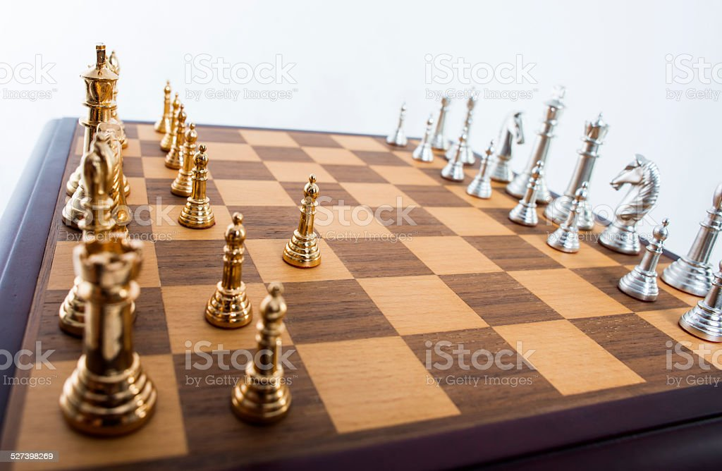 GOld and silver chess set stock photo