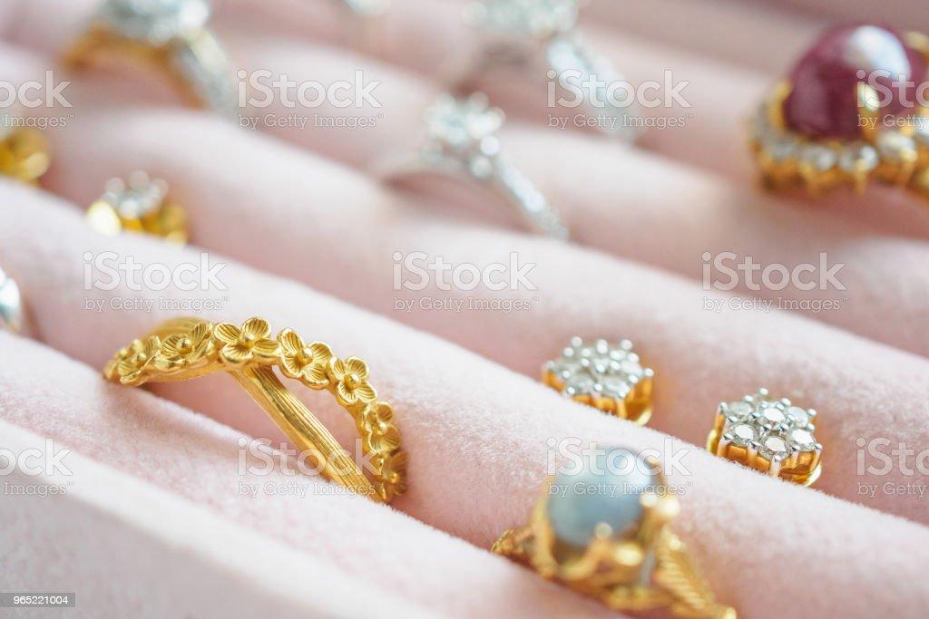 Gold and silver diamond gemstone ring and earrings in luxury jewelry box zbiór zdjęć royalty-free
