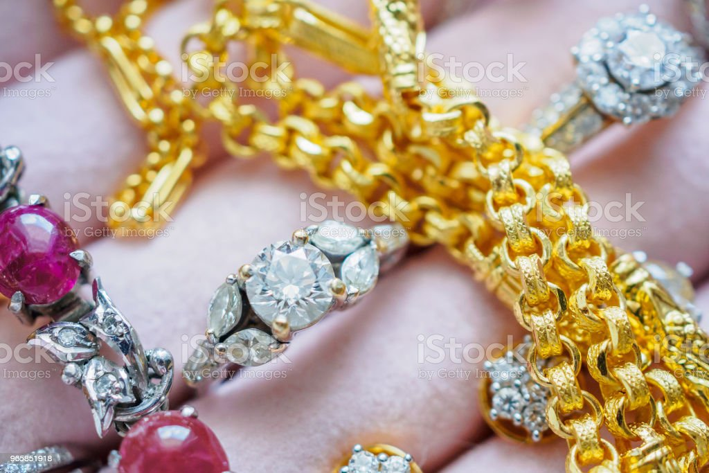 Gold and silver diamond gemstone ring necklaces and earrings in luxury jewelry box - Royalty-free Beauty Stock Photo