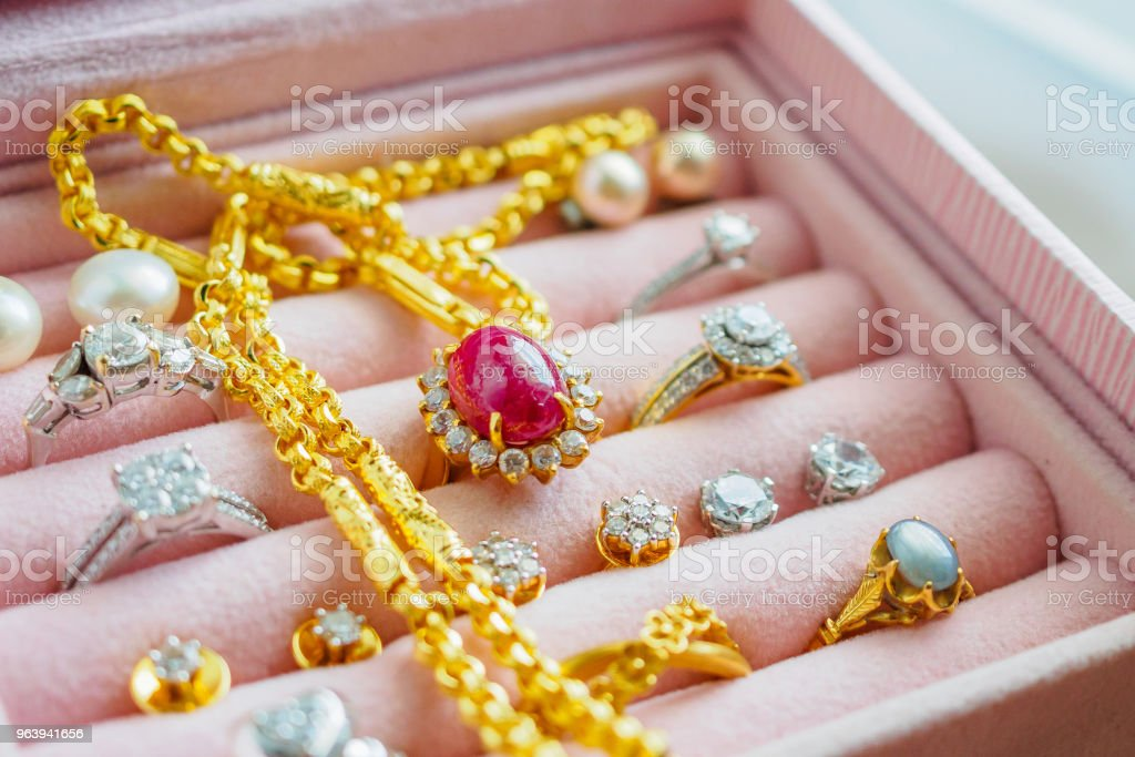Gold and silver diamond gemstone sapphire ring necklaces and pearl earrings in luxury jewelry box - Royalty-free Backgrounds Stock Photo