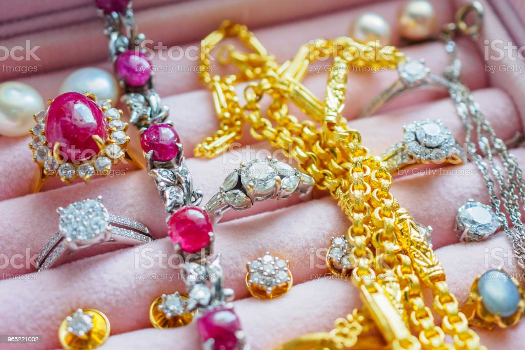 Gold and silver diamond gemstone sapphire ring necklaces and pearl earrings in luxury jewelry box royalty-free stock photo
