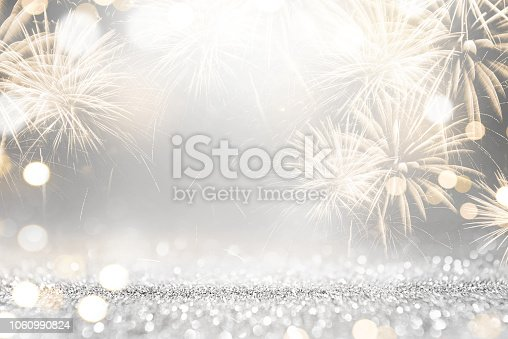 istock Gold and silver Fireworks and bokeh in New Year eve and copy space. Abstract background holiday. 1060990824