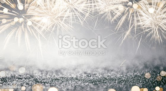 969086552istockphoto Gold and silver Fireworks and bokeh in New Year eve and copy space. Abstract background holiday. 1073604340