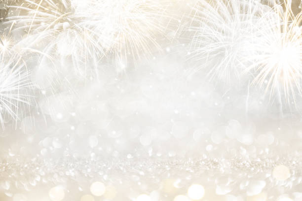 gold and silver fireworks and bokeh in new year eve and copy space. abstract background holiday. - oatawa stock pictures, royalty-free photos & images