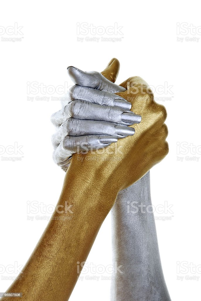 Gold and silver hands joined royalty-free stock photo