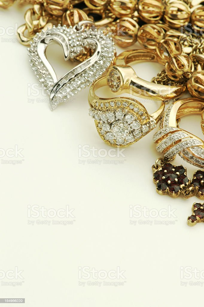 Gold and silver jewelry against white background royalty-free stock photo