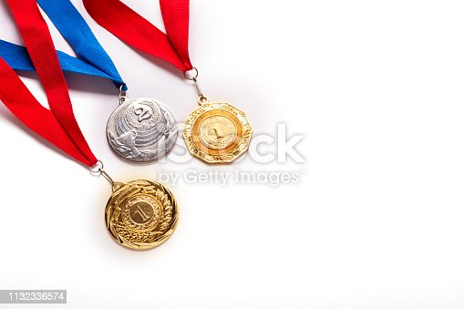 Gold and silver medals with ribbon on white background. Isolated. Copy space