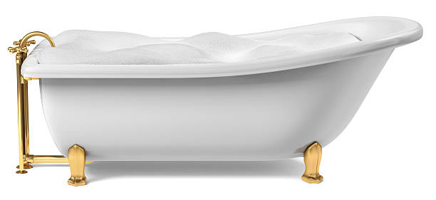 Gold and white clawfoot bathtub filled with bubbles A Cast-Iron standing bathtub on white with clipping path included bubble bath stock pictures, royalty-free photos & images