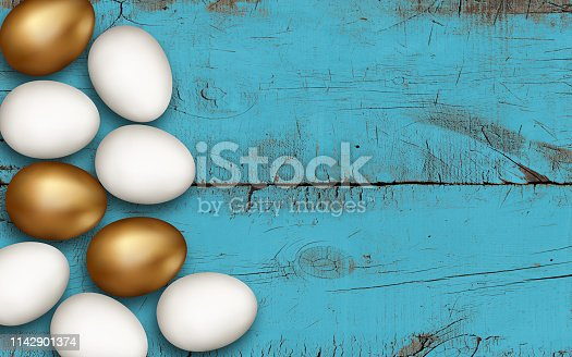 922843504 istock photo Gold and white easter eggs on blue brushed wooden background. Colorful golden Easter eggs on a wooden table. Rustic colored background. Invitation template design, greeting card, decoration 1142901374