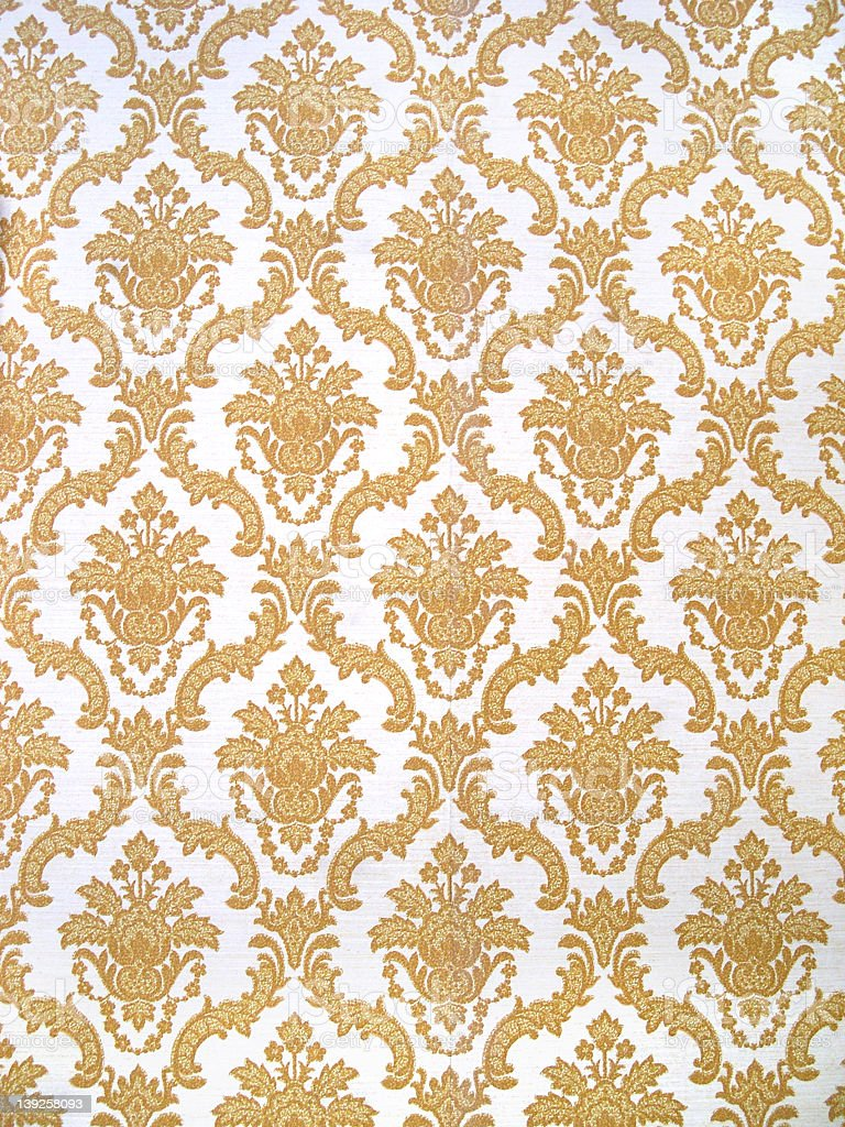 gold and white floral patterned wallpaper background stock