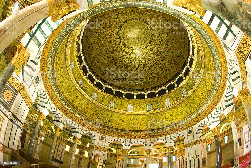 Gold and white high ceilings of the Dome of the Rock stock photo