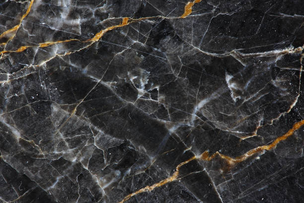 Gold and white Patterned natural of dark gray marble (Gold Russia) texture background for product design. stock photo