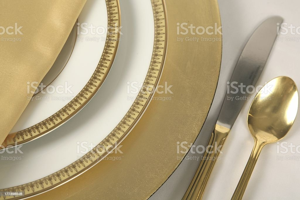 Gold and white Place Setting 1 royalty-free stock photo
