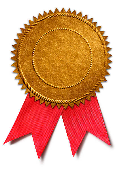 gold award seal with red ribbon - award ribbon stock photos and pictures