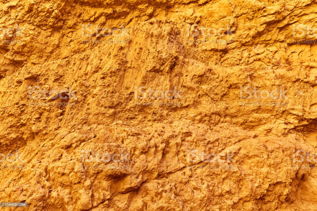 Gold background and texture of stone surface, natural pattern stock photo