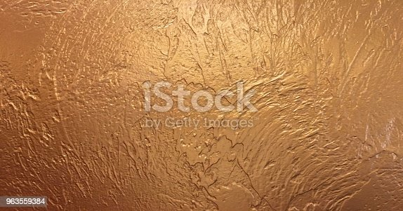 istock Gold background or texture and gradients shadow. Shiny yellow leaf gold foil texture background. 963559384