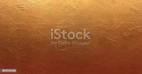 istock Gold background or texture and gradients shadow. Shiny yellow leaf gold foil texture background. 963559398