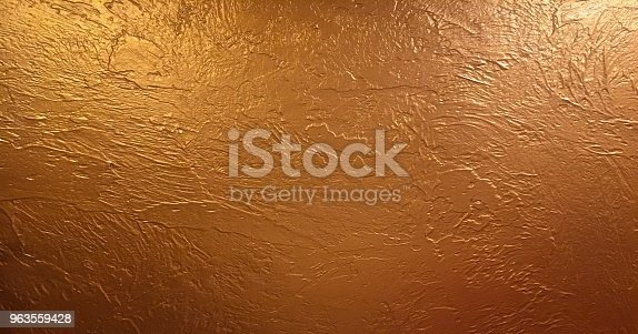 istock Gold background or texture and gradients shadow. Shiny yellow leaf gold foil texture background. 963559428
