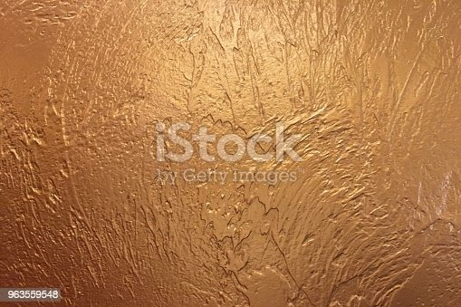 istock Gold background or texture and gradients shadow. Shiny yellow leaf gold foil texture background. 963559548