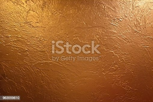 istock Gold background or texture and gradients shadow. Shiny yellow leaf gold foil texture background. 963559610