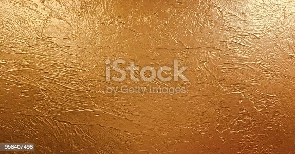 istock gold background paper, texture is old vintage distressed solid glitter gold color with rough peeling grunge paint on edges. 958407498
