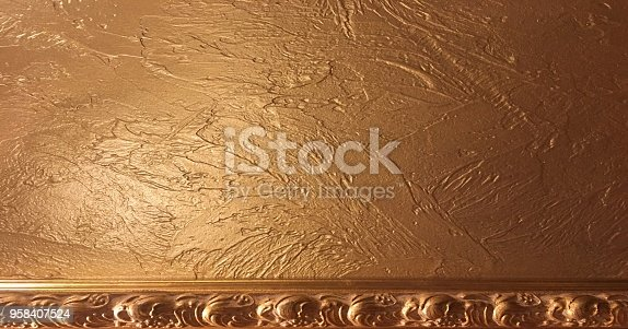 istock gold background paper, texture is old vintage distressed solid glitter gold color with rough peeling grunge paint on edges. 958407524