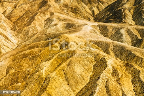 These mountains in Death Valley National Park looks like they are made of shiny glittering gold.