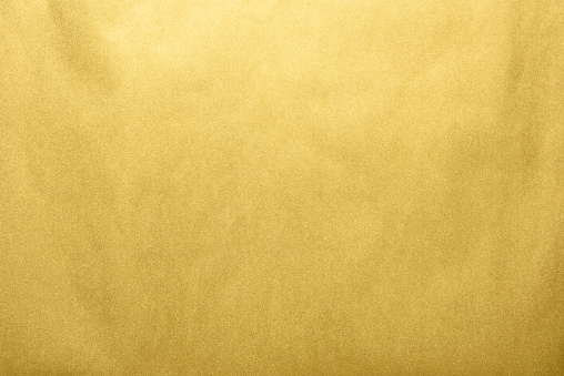Close-up shot of abstract gold background.