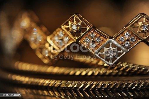 A macro shot of jewellery - Gold Bangles