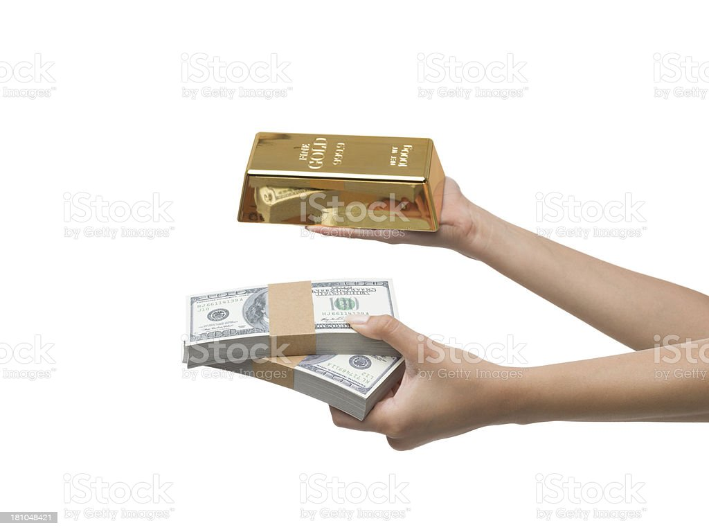 Gold bar and dollar bills in woman hand royalty-free stock photo