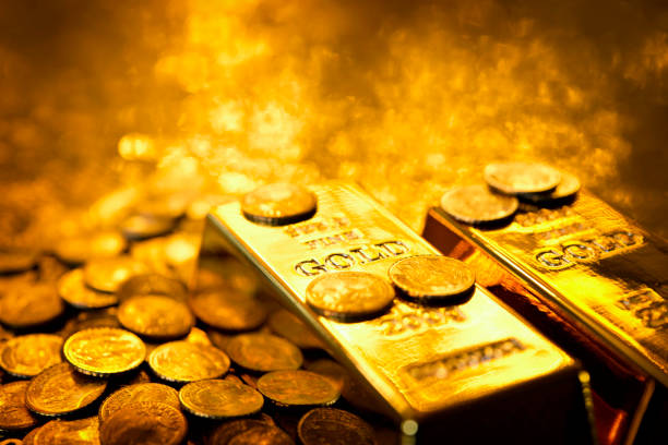 gold bars and coins - coin stock photos and pictures