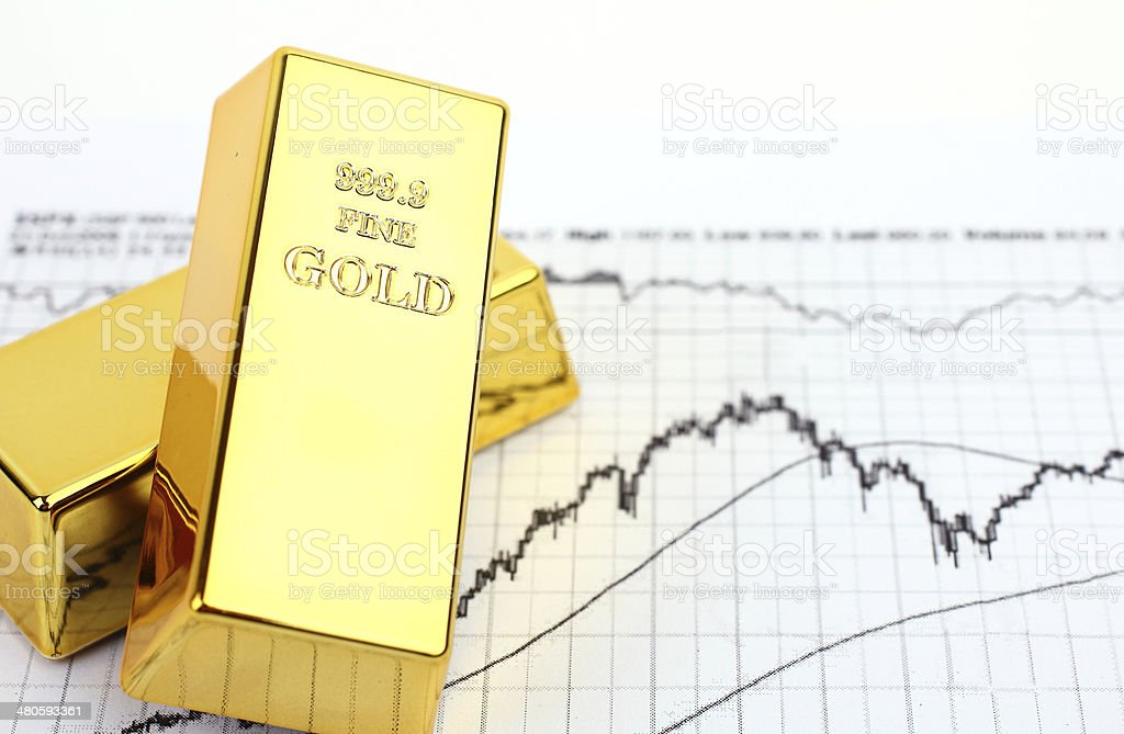 Gold bars and financial graph stock photo