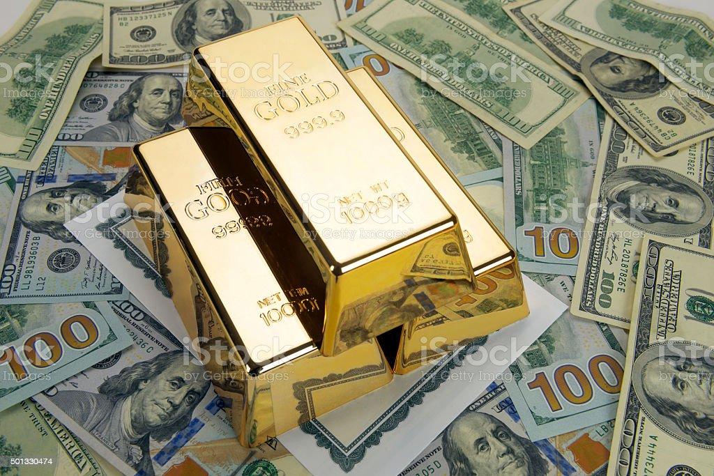 Gold bars on dollars stock photo