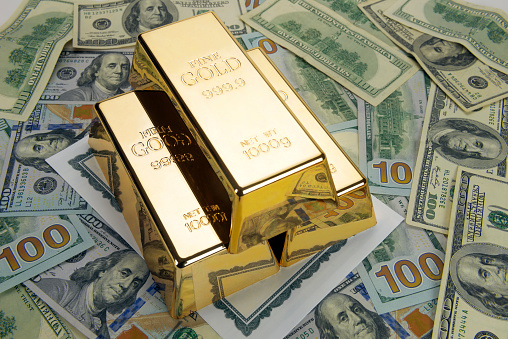 Gold Bars On Dollars Stock Photo - Download Image Now