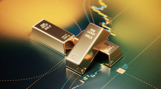 Gold Bars Sitting over A Bar Graph - Stock Market and Finance Concept stock photo