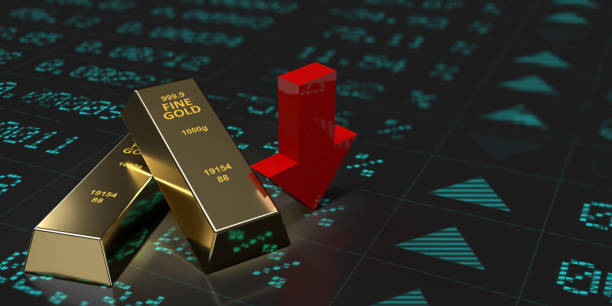 Gold bars with red down arrow on financial graph. stock photo