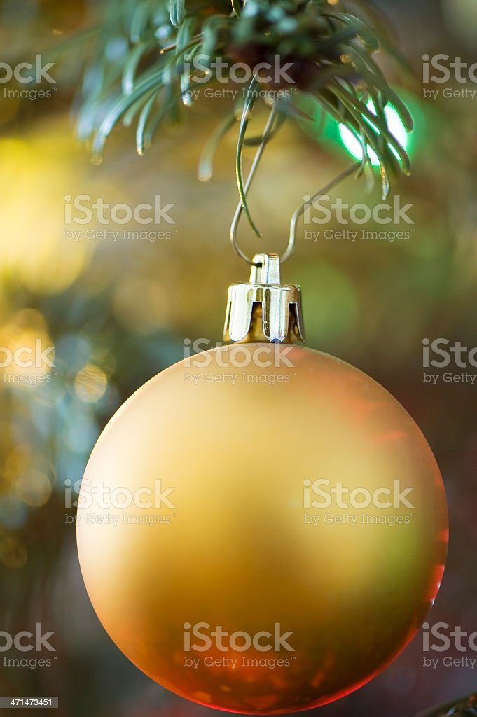 Gold Bauble in Christmas Tree royalty-free stock photo