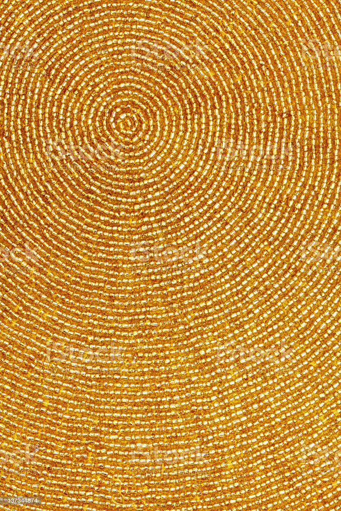 Gold Beads in a Circular Pattern for Background royalty-free stock photo