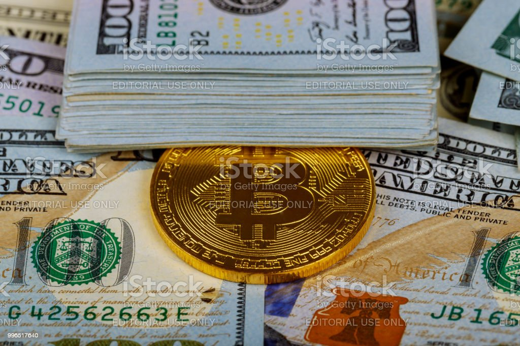 Gold Bitcoin Coins On One Hundred Us Dollar Bills Background