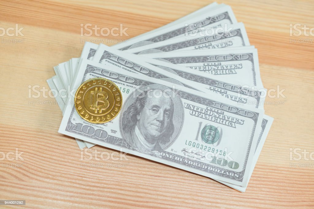 Gold Bitcoin Placed On A 100 Dollar Banknotes Digital Currency