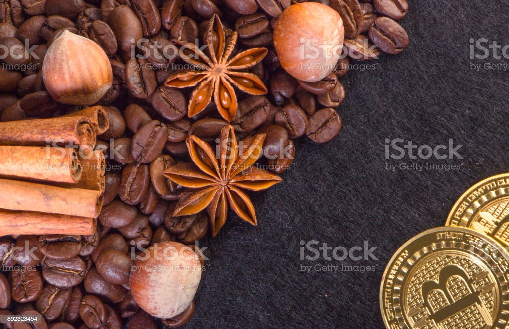 Gold Bitcoin surround by coffee bean stock photo