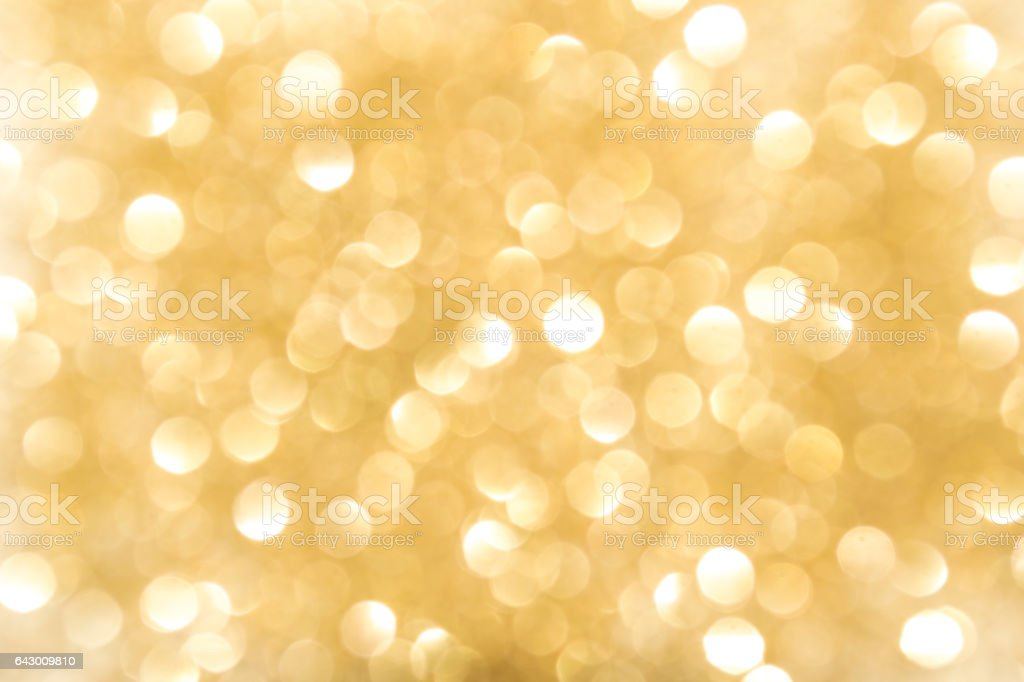 Gold Bokeh Background. The background with boke. Abstract texture. Color circles. Blurred. stock photo