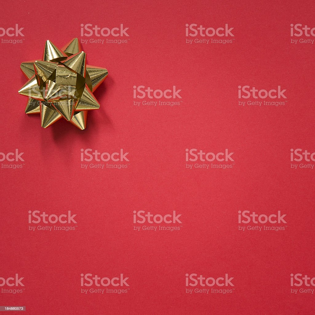 Gold bow on christmas red background stock photo