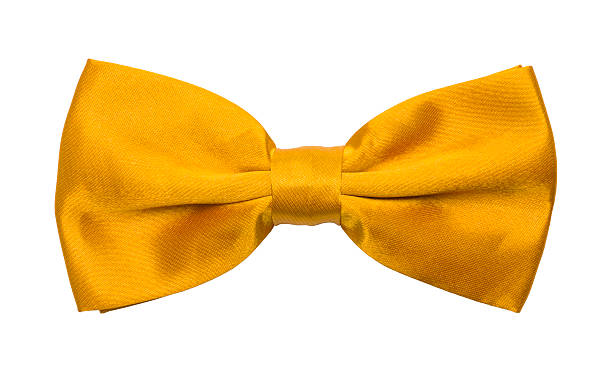 Gold Bow Tie Yellow Tuxedo Bowtie Isolated on a White Background. bow tie stock pictures, royalty-free photos & images