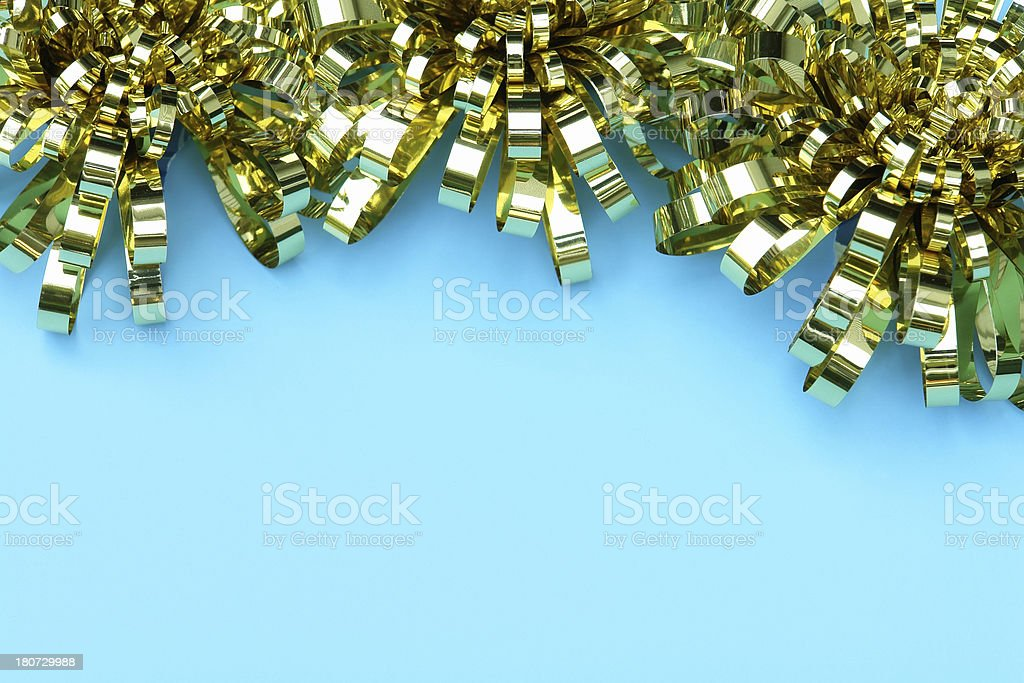 Gold bows on sky blue royalty-free stock photo