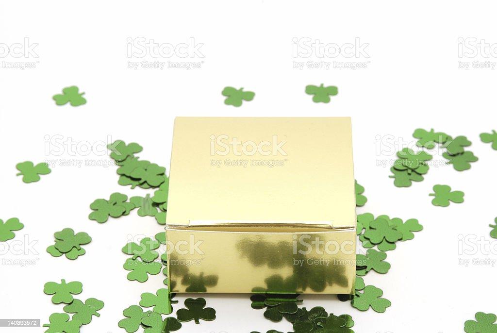 Gold Box on Shamrocks royalty-free stock photo