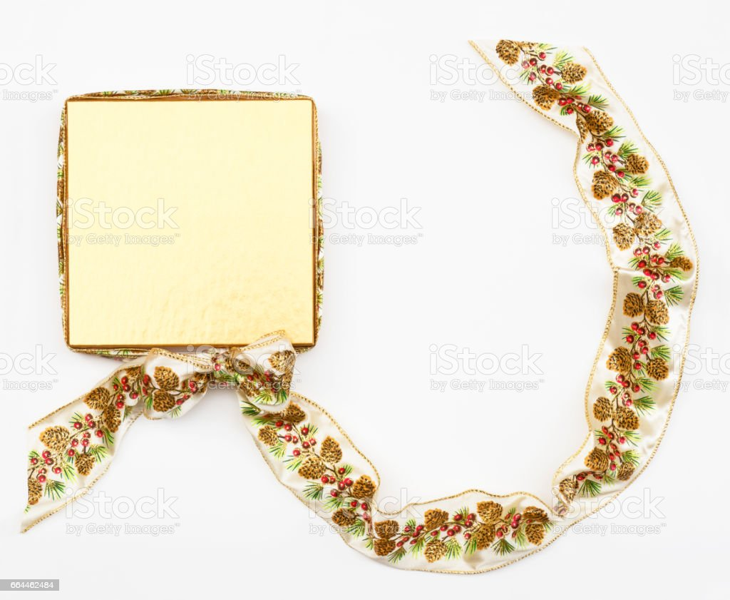 Gold Box with Pine Cone Ribbon stock photo
