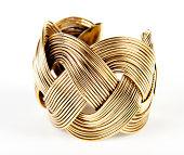 gold bracelet on white background